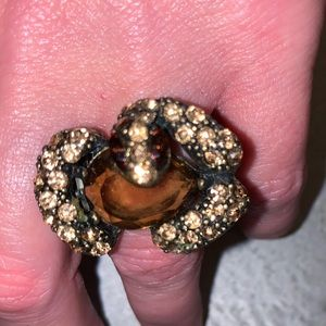 Stretchy snake ring with yellow/orange stones.